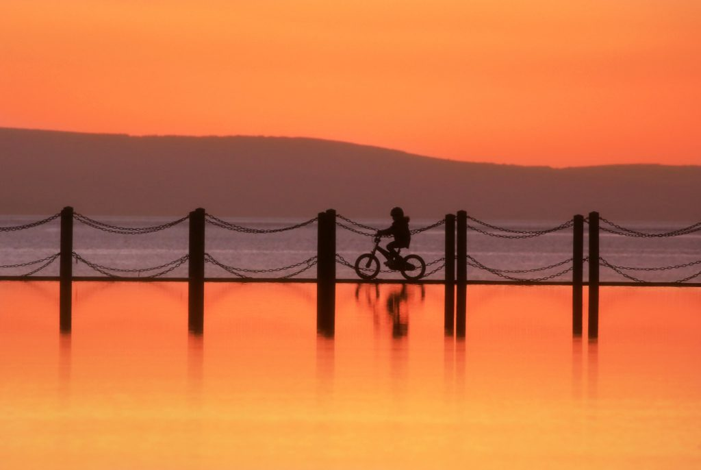 Tangerine Sunset. Cycling on the water Marine Causeway Weston-Super-Mare by Paul Silvers @Cloud9weather1