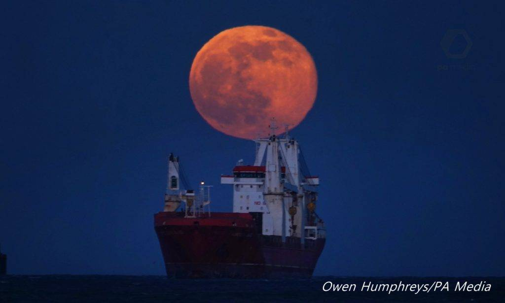 Snow Moon as it rises over a Cargo ship on the North Sea off the coast of Tynemouth UK by Owen Humphreys @owenhumphreys1