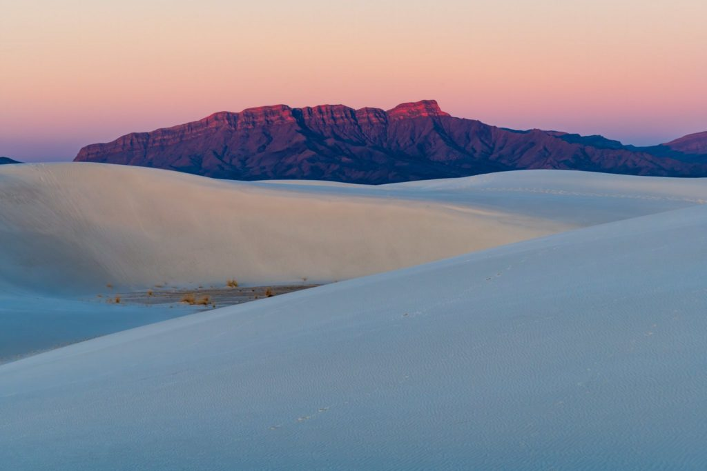 3rd Place A warm glow during sunrise at White Sands National Park, New Mexico by Michael Ryno Photo @mnryno34