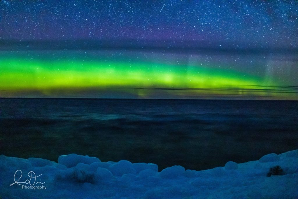 The glow of the Northern Lights light up Lake Superior by isaac @ID_Photo_Graphy
