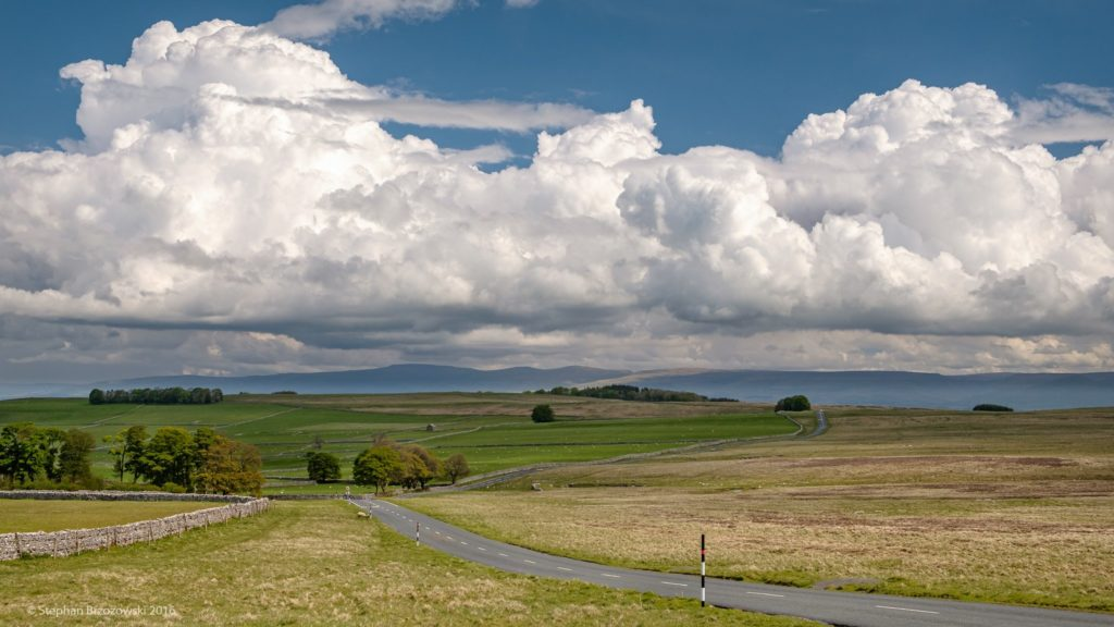 1st Place Cumulus clouds dwarfing the highest fells of the North Pennines, seen from Orton Scar in Cumbria by Stephan Brzozowski @stephanbrz