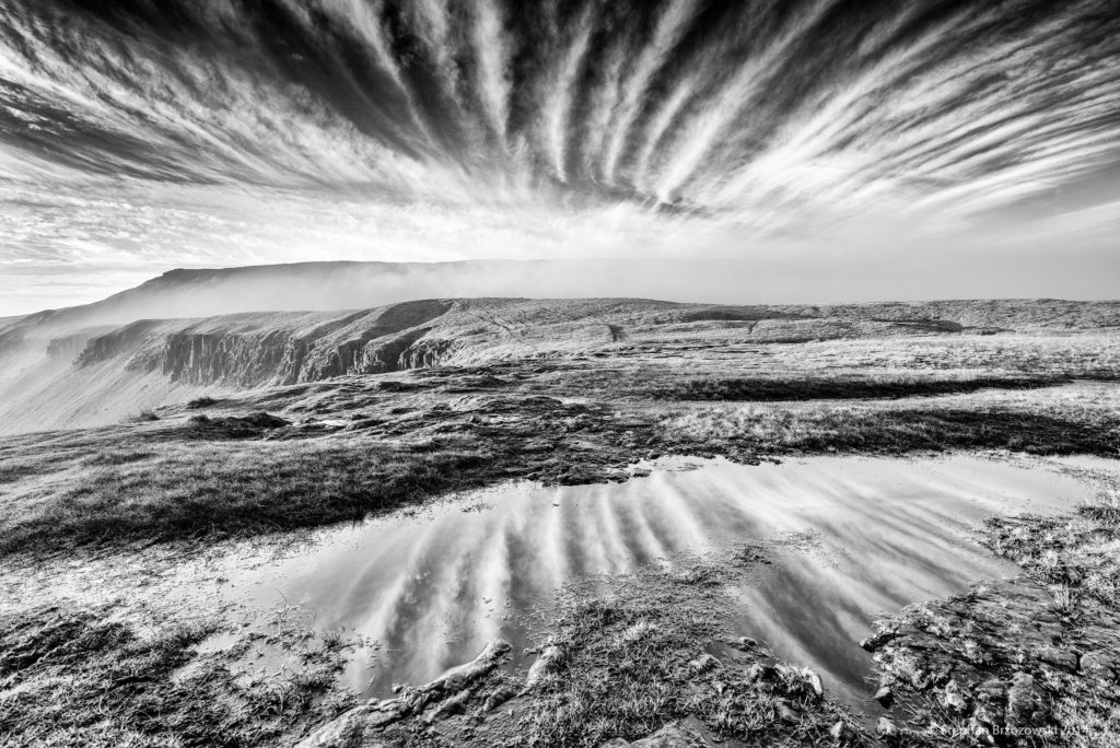 3rd Place Fan-shaped display of cirrus cloud over High Cup Nick in the North Pennines of Cumbria by Stephan Brzozowski @stephanbrz