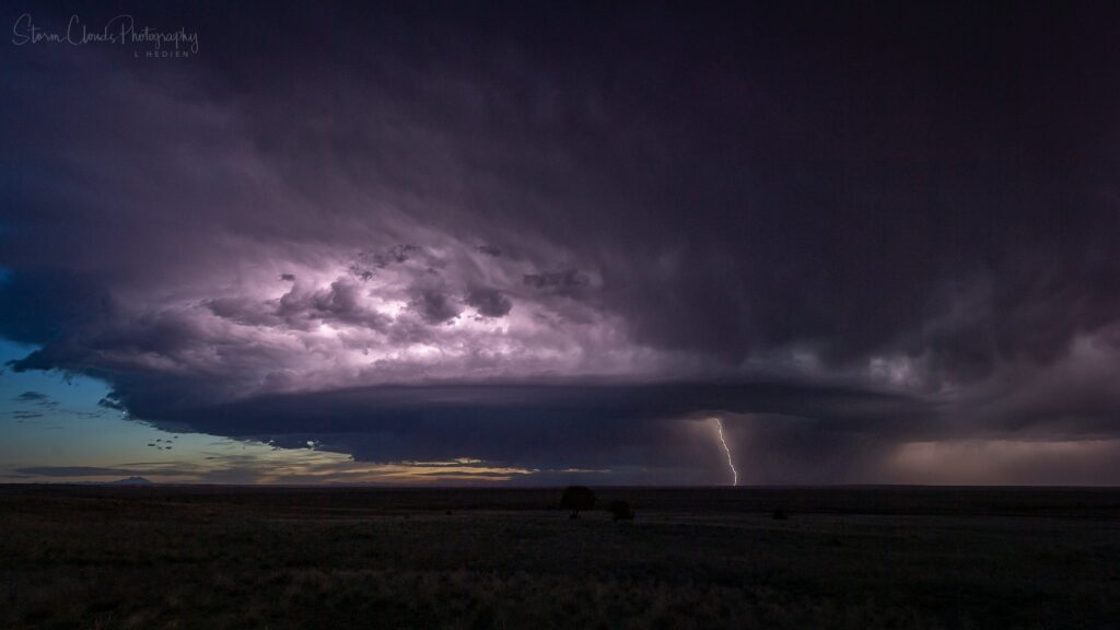 3rd Place lightning and a supercell on the Great Plains by Laura Hedien @lhedien