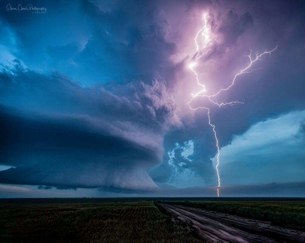 2nd Place Selden, Kansas supercell droppping lightning during a June storm by Laura Hedien- Storm Clouds Photography @lhedien