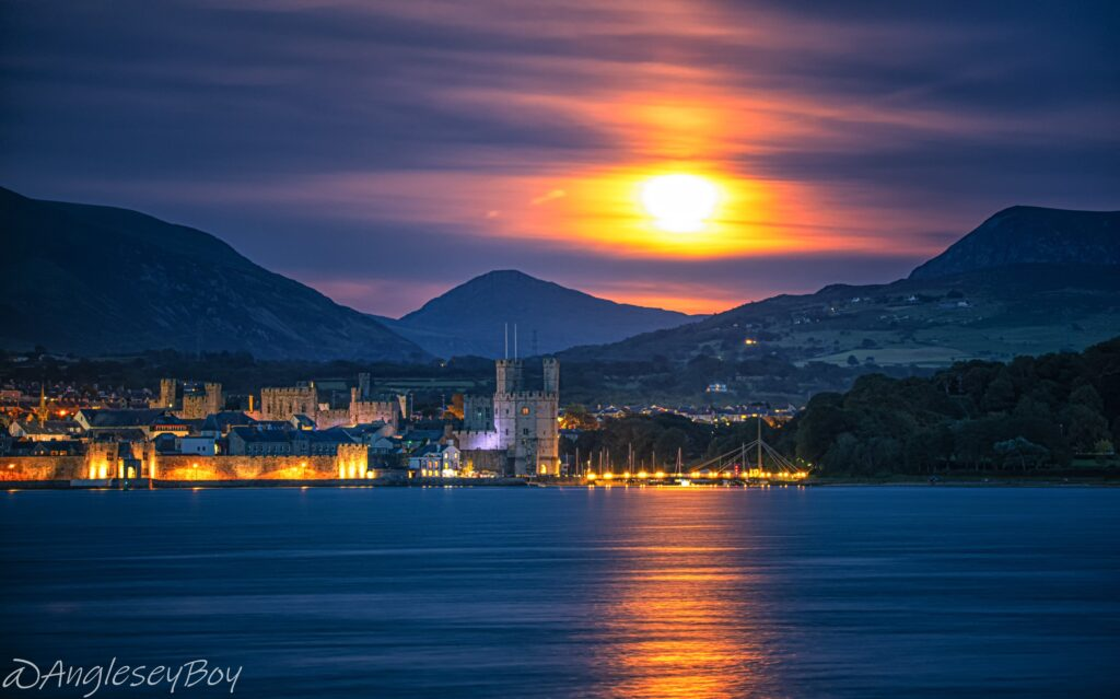 1st Place Sturgeon moon rising over Caernarfon Castle by Phil Taylor @angleseyboy