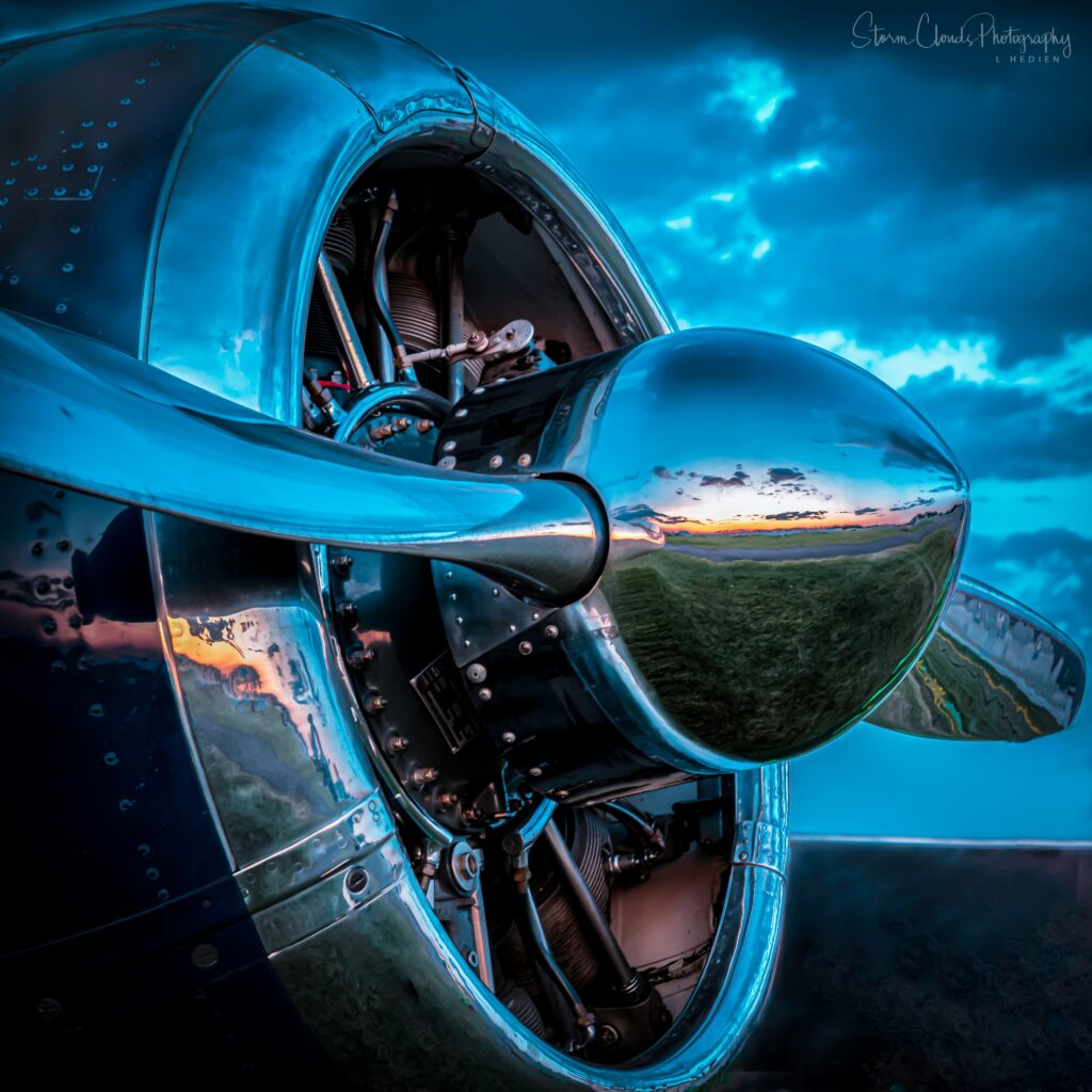 3rd Place Sunset reflection on the nose of a vintage aircraft by Laura Hedien @lhedien