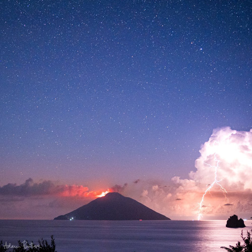 1st Place A terrific thunderstorm beside the erupting volcanic island of Stromboli, off Sicily by Adam Butler @adambutler65