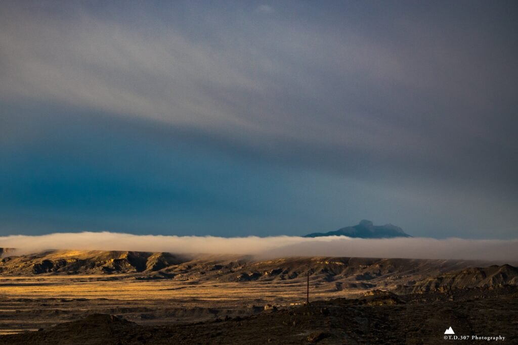 2nd Place Heart Mountain faintly peaks above a roll of fog that feathers down Elk Basin Ridge by TankTopTony @TonyD2155