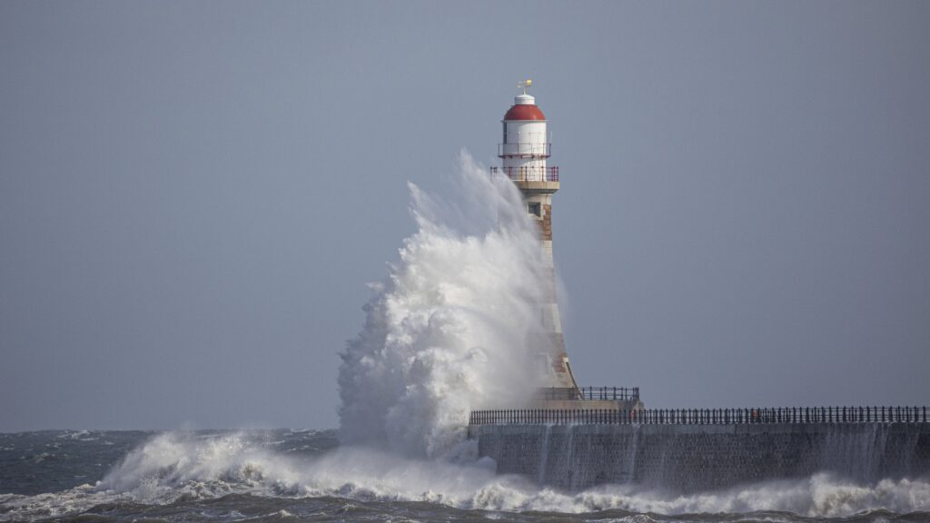 1st Place A beautiful wave hits Roker Lighthouse by simon c woodley @simoncwoodley