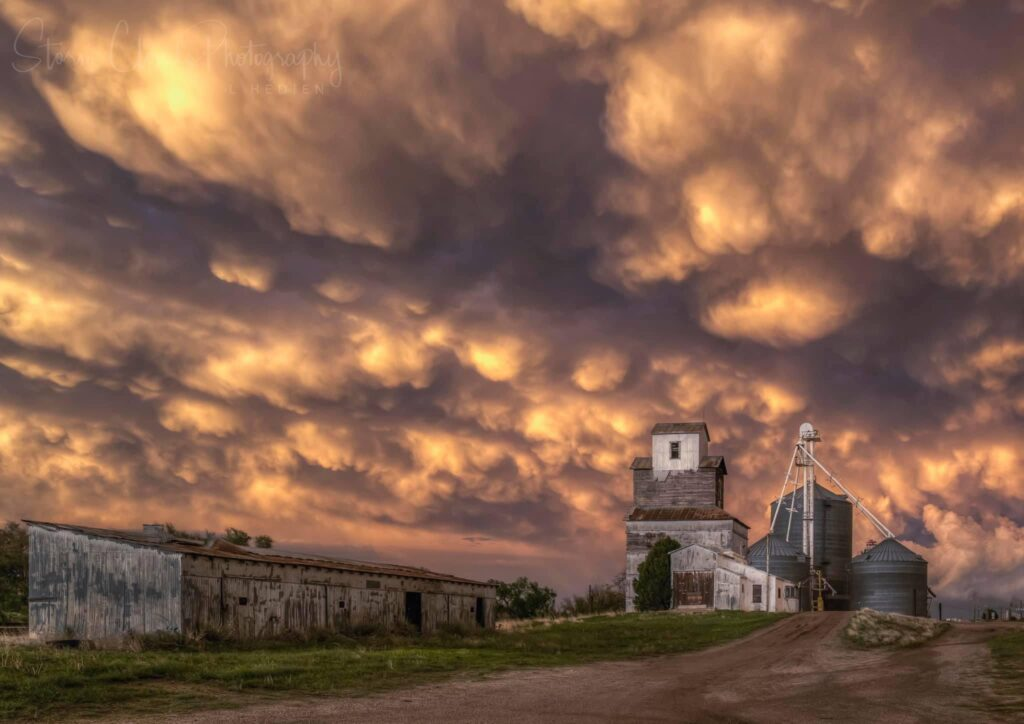 2nd Place Mammatus over a grain elevator in Colorado by Laura Hedien @lhedien