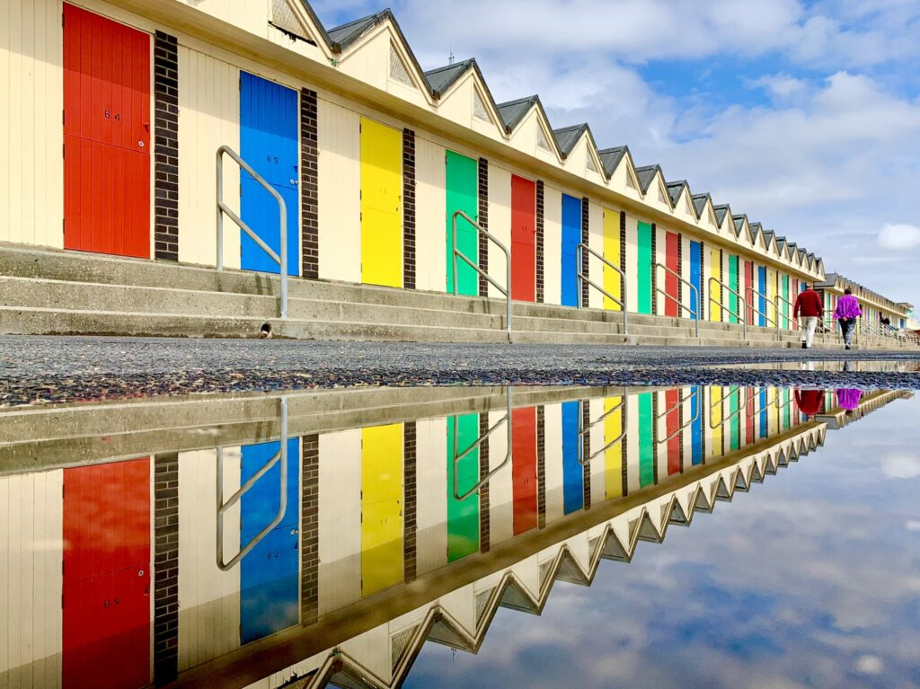 3rd Place Beach chalets reflected in the puddles at Kirkley, Suffolk by WalkingTractor @TractorWalking